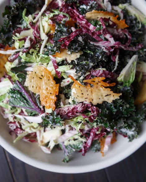 Kale Caesar Salad with Brussels Sprouts and Radicchio
