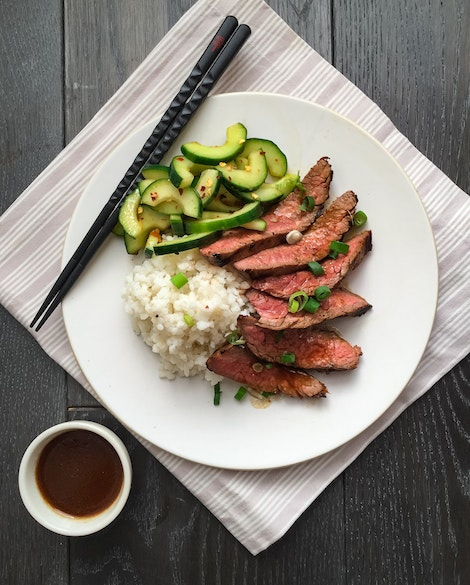 Korean-Style Grilled Flank Steak with Spicy Cucumbers and Sticky Rice