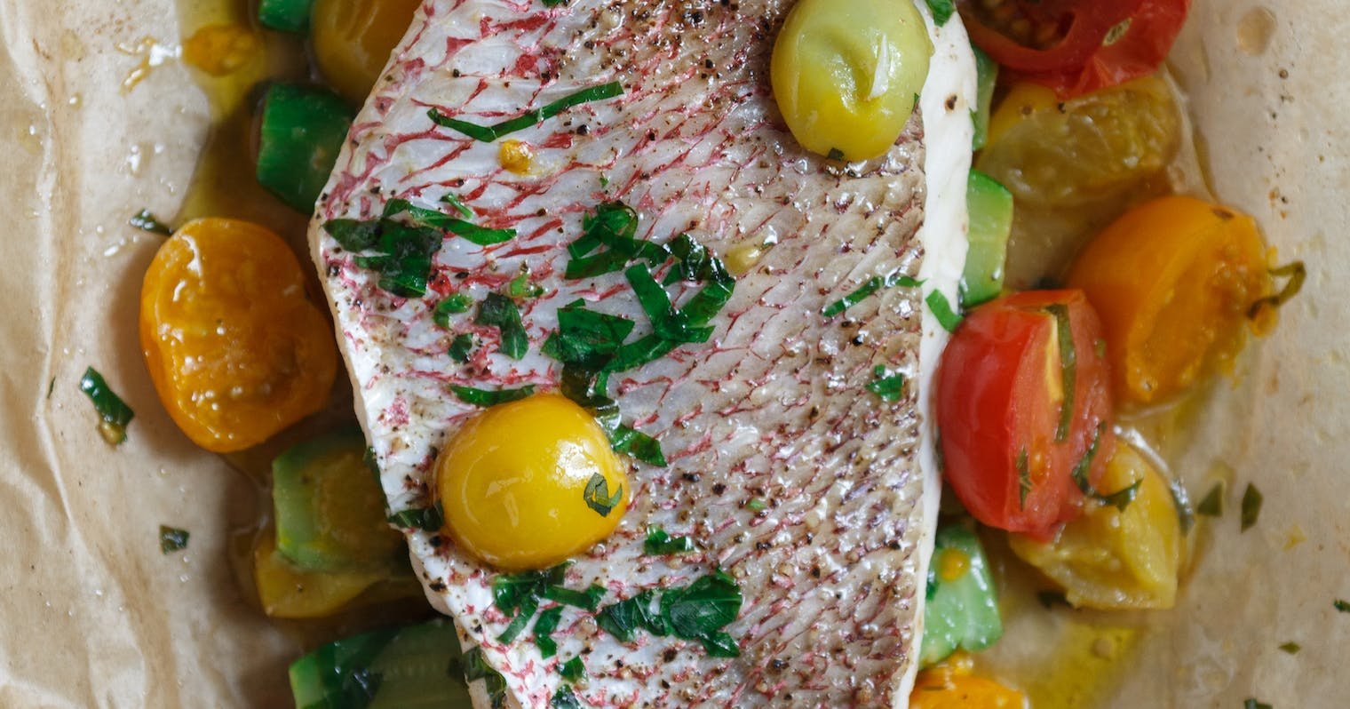 Best parchment roasted redfish with summer vegetables for Red fish taste