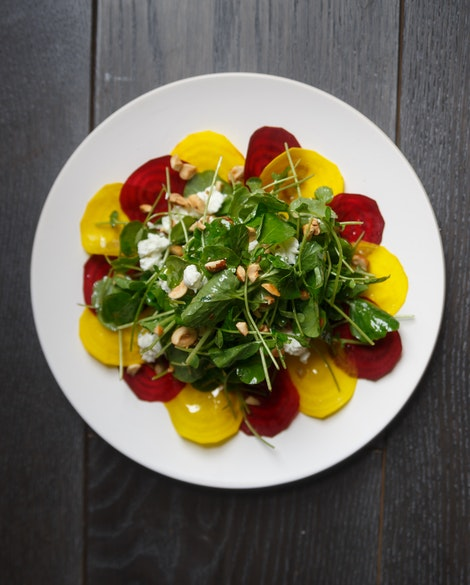 Raw Beet Salad with Baby Arugula, Goat Cheese, and Hazelnuts